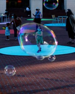 Girl with mask in a bubble